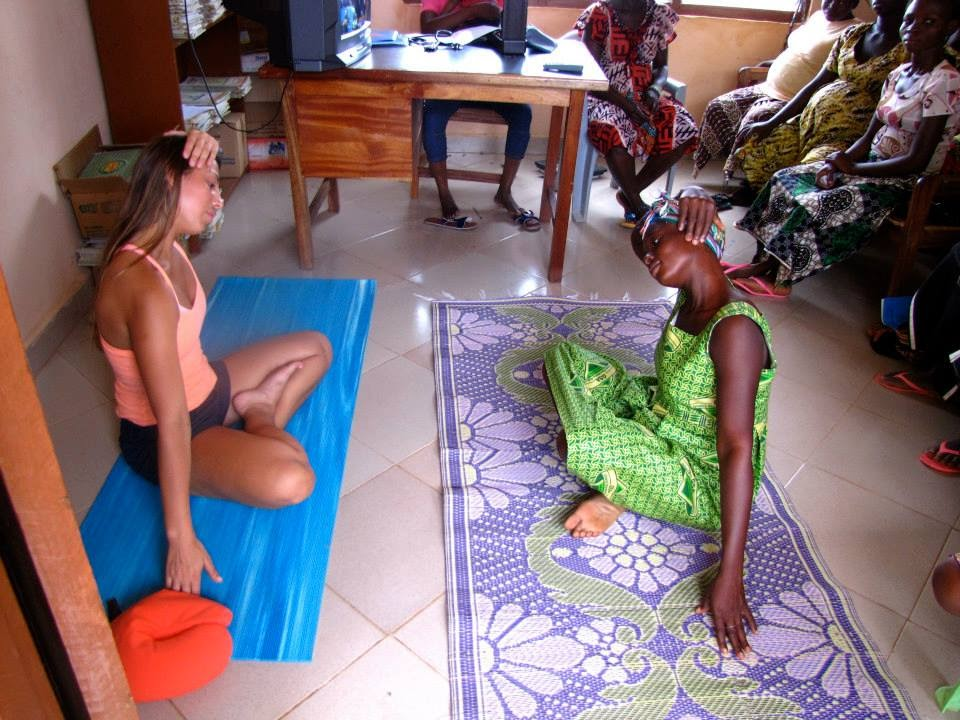 allyson anatra instructing neck stretch in maternity clinic Ghana West Africa