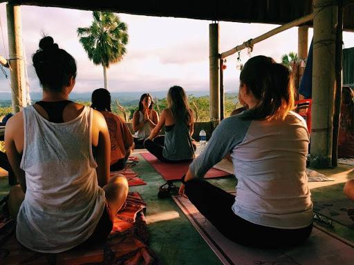 allyson anatra travel yoga teacher namaste hands yoga class in dominican republic